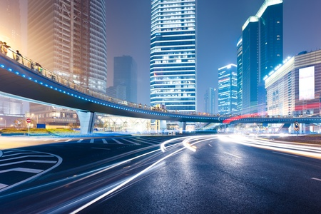 dynamic motion: the light trails on the modern building background in shanghai china. Stock Photo