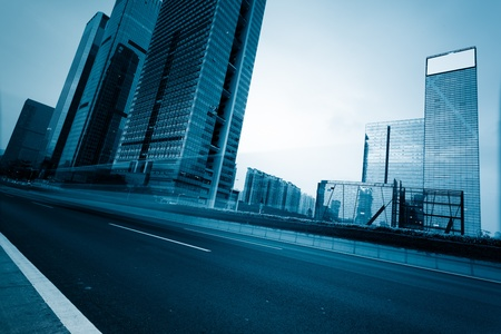 the light trails on the modern building background in shanghai china. 스톡 콘텐츠