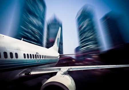 aiplane fly through city. Stock Photo