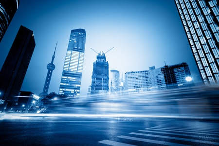 the light trails on the modern building background in shanghai china. Zdjęcie Seryjne