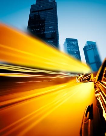 accelerate: speeding car through the street of shanghai china in night. Stock Photo