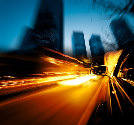 speed car: speeding car through the street of shanghai china in night. Stock Photo