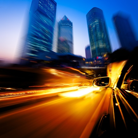 speeding car through the street of shanghai china in night. Stock Photo