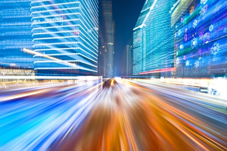light speed: the light trails on the modern building background in shanghai china. Stock Photo