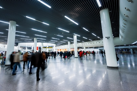 blur subway: Futuristic  Airport interior people walking in motion blur
