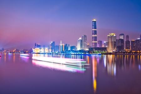 east river: Zhujiang River and modern building of financial district at night in guangzhou china. Stock Photo