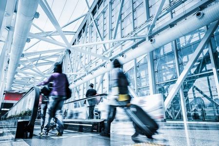 Futuristic guangzhou Airport interiorpeople walking in motion blur Standard-Bild