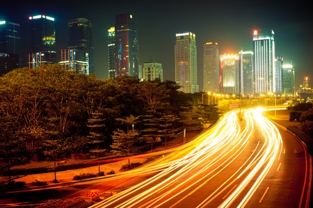 the light trails on the modern building background in shanghai china. Standard-Bild