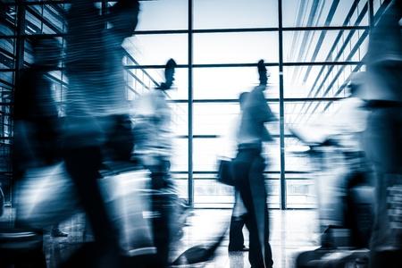 Futuristic  Airport interiorpeople walking in motion blur Standard-Bild