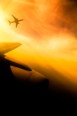 cockpit: airplane fly at sunset sky background. Stock Photo