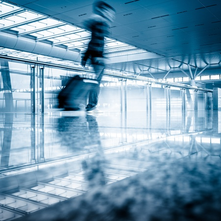 Futuristic  Airport interior people walking in motion blur photo