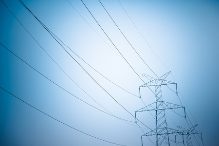 power lines: High voltage towers at sunset, blue toned images. Stock Photo