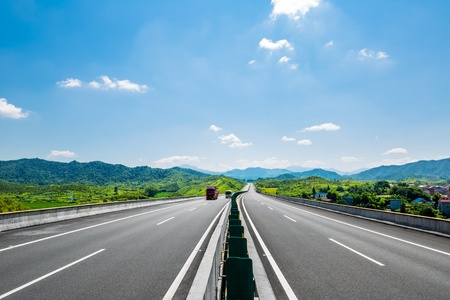 clean freeway go through the county field by day. Standard-Bild