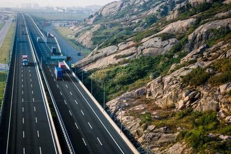 autobahn: motion trucks on the freeway. Stock Photo
