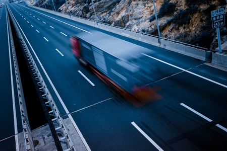 night highway: motion trucks on the freeway. Stock Photo