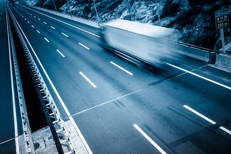 fast delivery: motion trucks on the freeway. Stock Photo