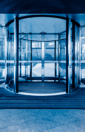 Revolving door ,blue toned image.