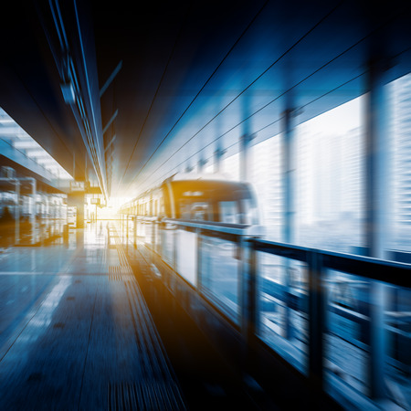 blue  toned: subway approaching,chongqing china,blue toned image.