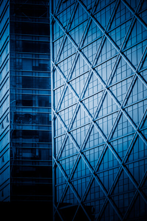 steel tower: modern building exterior,blue toned image. Editorial