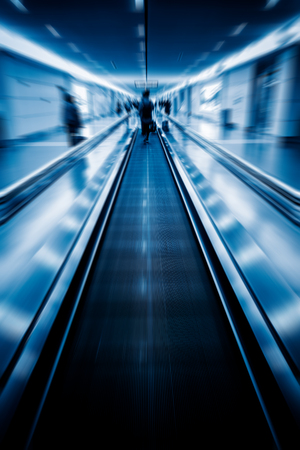 toned: moving walkways at airport,blue toned image.