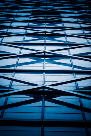 blue  toned: modern building exterior,blue toned image. Editorial