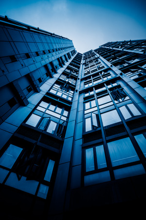 live work city: low angle view of highrise building,blue toned image,shanghai china. Editorial
