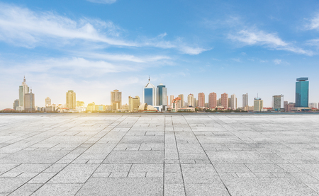 empty tiled floor with city skyline under cloudy sky,chongqing china. Standard-Bild