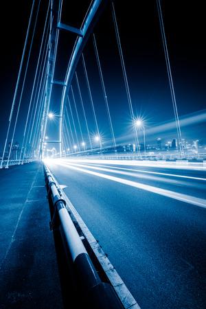 blue  toned: traffic trails on bridge,chongqing china,blue toned image.