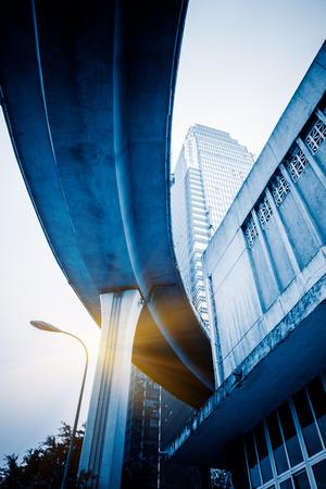 overbridge: low angle view of chongqing interchange and skyscraper Stock Photo