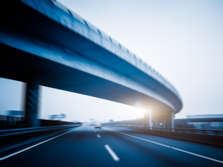 overbridge: car driving on the highway,blue toned.