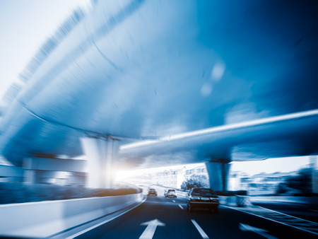 blue  toned: car driving under the overpass,blue toned image.