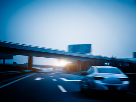 overbridge: car driving on the highway,motion blurred,blue toned image.