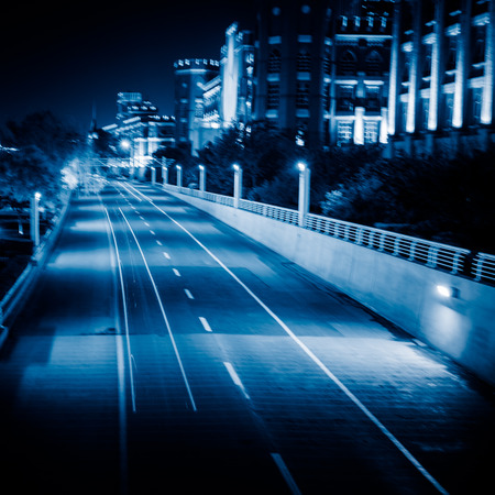 light trails: light trails with skysrapers background,tianjin china.