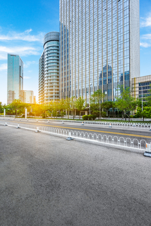 urban road: clean road with modern buildings background