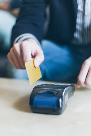 cardreader: man preparing for swiping credit card on wireless POS machine