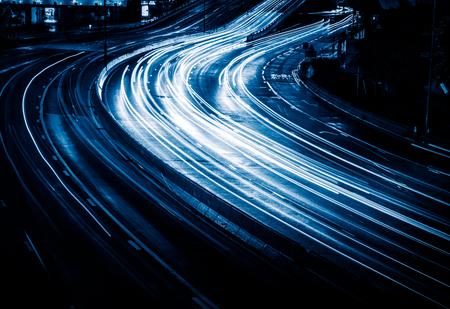 hongkong: light trails in the downtown district,hongkong china,blue toned image.