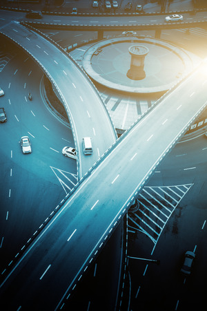 highway traffic: aerial view of traffic on chongqing overpass on a sunny day,china
