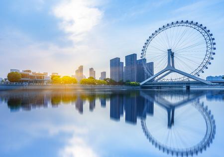 landmark skyline of tianjin city,china.Chihai Bridge Ferris Wheel,Tianjin Eye. Standard-Bild