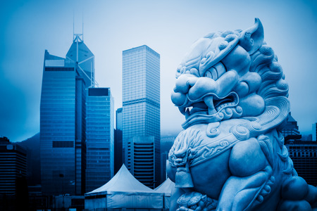 closedup: closed-up view of stone lion,shanghai famous skyscrapers,blue stoned image.