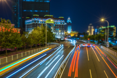 light trails: light trails in the downtown district,hongkong china.