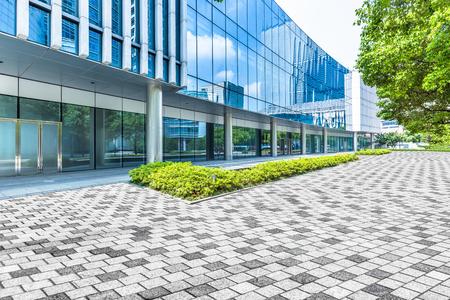 building entrance: modern building entrance,blue toned image.