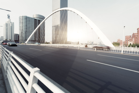 urban traffic on bridge with cityscape in background
