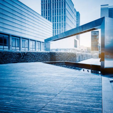 empty wooden floor with modern building in city