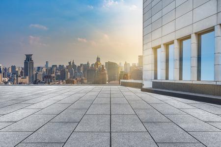 urban sprawl: empty brick floor with city skyline background Stock Photo