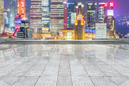 tiled floor: empty tiled floor with city skyline background