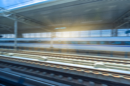 highspeed: high-speed rail arriving at station Stock Photo