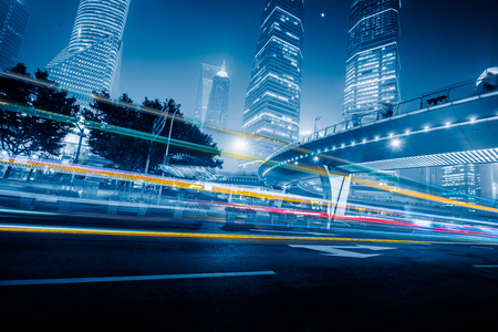 traffic building: vehicle light trails at city road,shanghai,china.