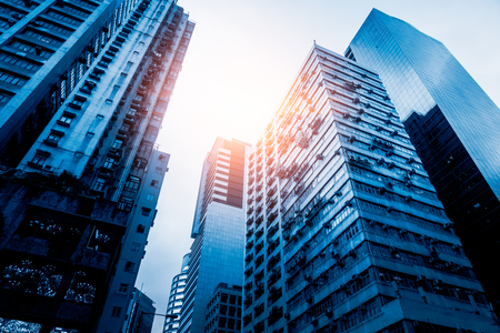 low angle view of modern metallic skyscrapers,blue toned,suzhou,china. Stock Photo