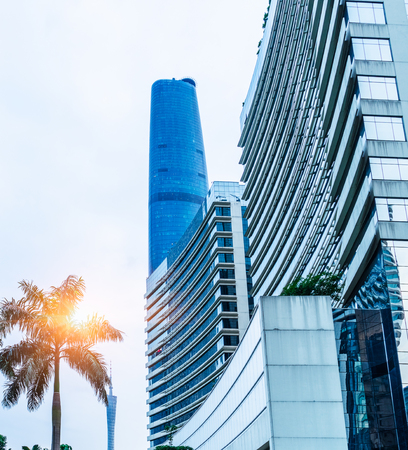 low angle view of modern metallic skyscrapers,blue toned,suzhou,china. Editorial