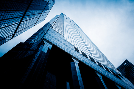 low angle view: low angle view of modern metallic skyscrapers,blue toned,suzhou,china. Stock Photo